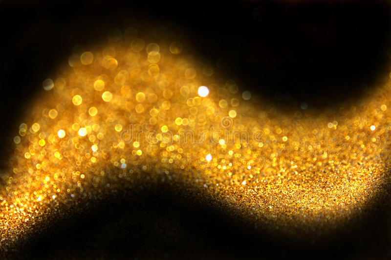 Golden abstract glitter trail made of defocused lights royalty free stock images