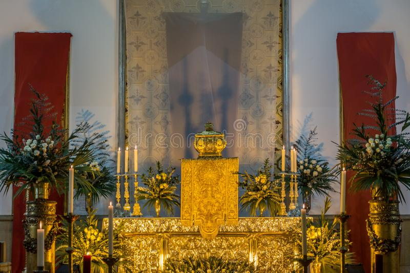 Golden altar of a church with flowers royalty free stock image