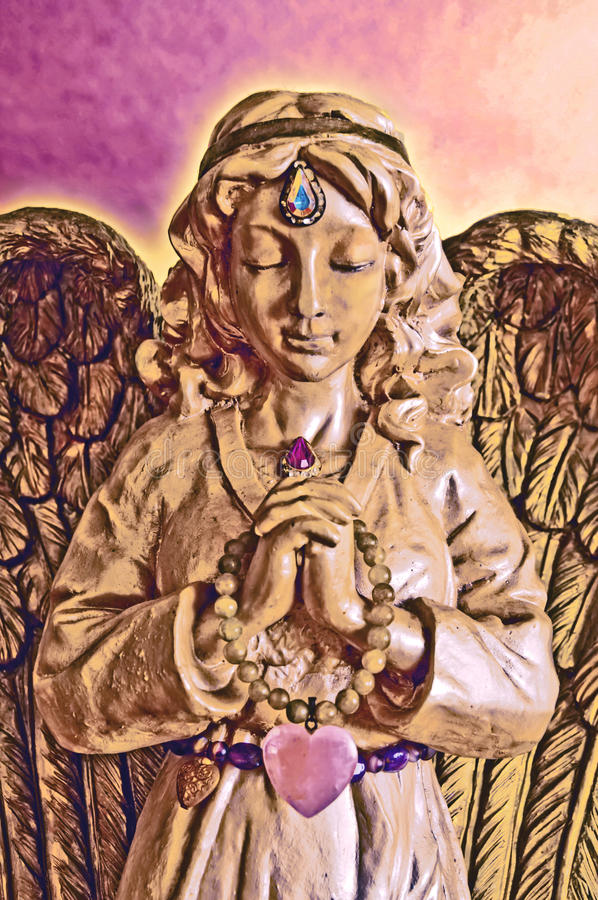 Golden Angel Statue in Prayer with eyes closed stock images