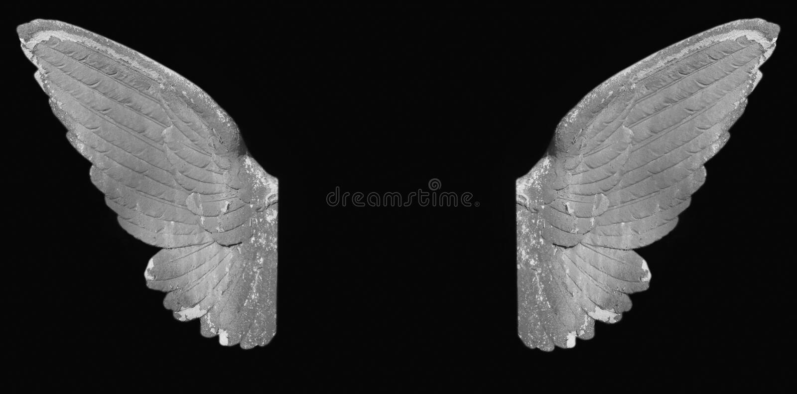 Golden angel wings. Angel wings as a symbol of goodness and holiness royalty free stock photography