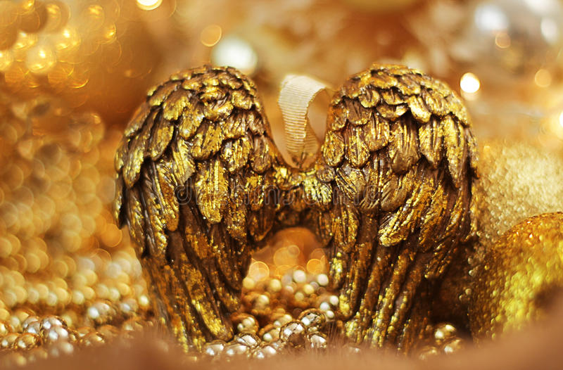 Golden angel wings. With golden background royalty free stock images