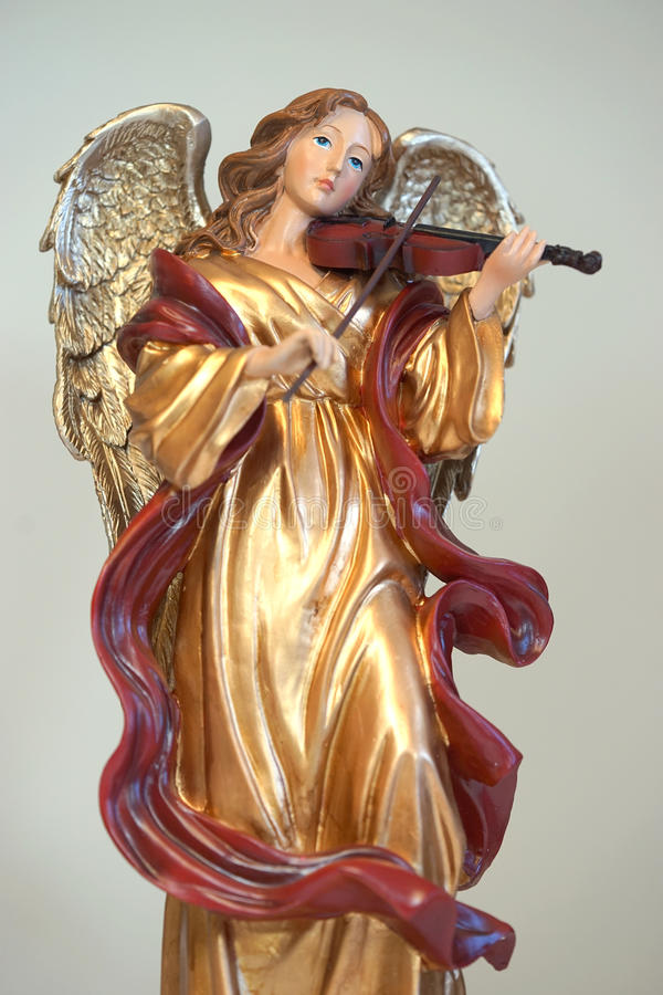 Golden angelic musician royalty free stock photography