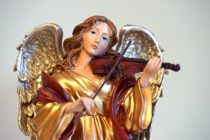 Golden angelic violin musician - horizontal royalty free stock photo