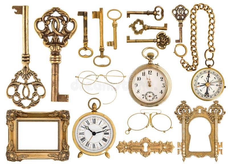 Golden antique accessories. baroque frame, vintage keys, clock stock images