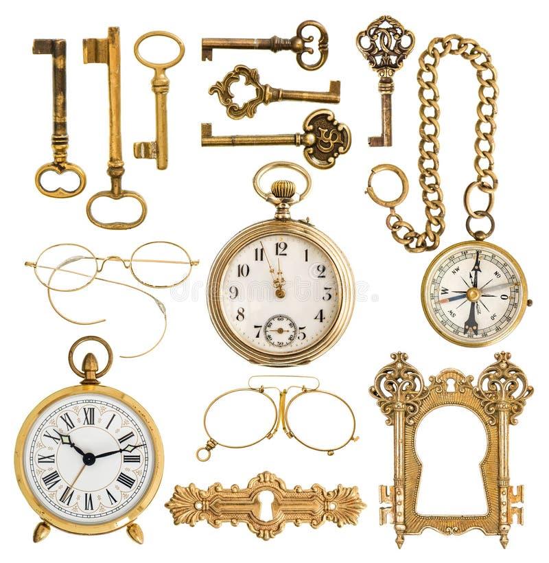 golden antique accessories. vintage keys, clock, compass, glasses, pocket watch, frame stock images