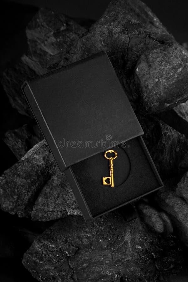 Golden Antique Key in a Black Box - Success Concept. Golden Antique Key in a Black Box on black background - Success Concept stock photography