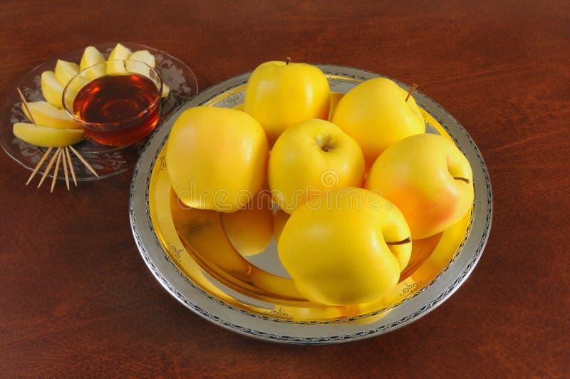 Golden apples & honey royalty free stock photo