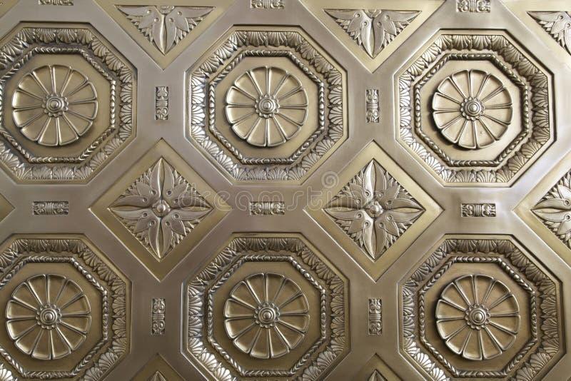 Golden Architecture. Golden decorative patterned door, Background stock photos