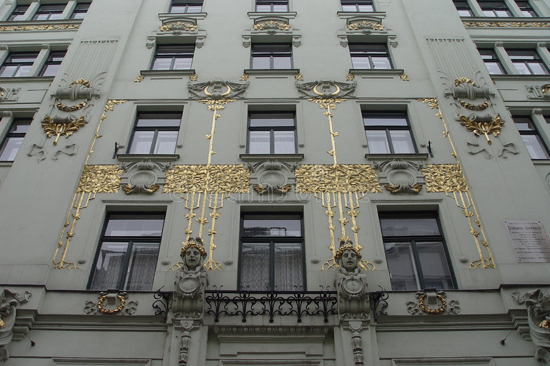 Golden art-nouveau facade. An ornate jugendstil facade on a Vienna apartment building royalty free stock photo