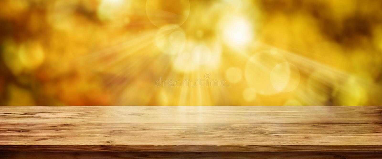 Golden autumn background with table royalty free stock photography