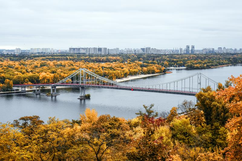 Golden autumn in Kiev, Ukraine. View on footbridge, river Dnieper and Trukhanov Island in Kyiv. stock photos