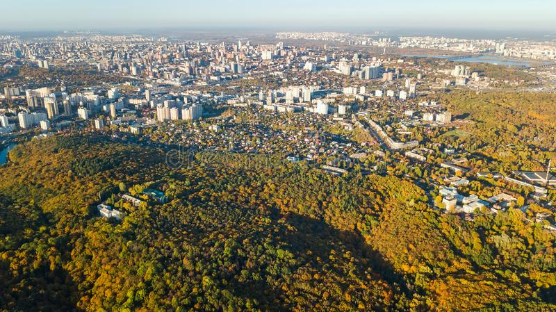 Golden autumn Kyiv cityscape, aerial drone view of city skyline and forest with yellow trees and beautiful landscape from above. Kiev, Goloseevo forest stock photography