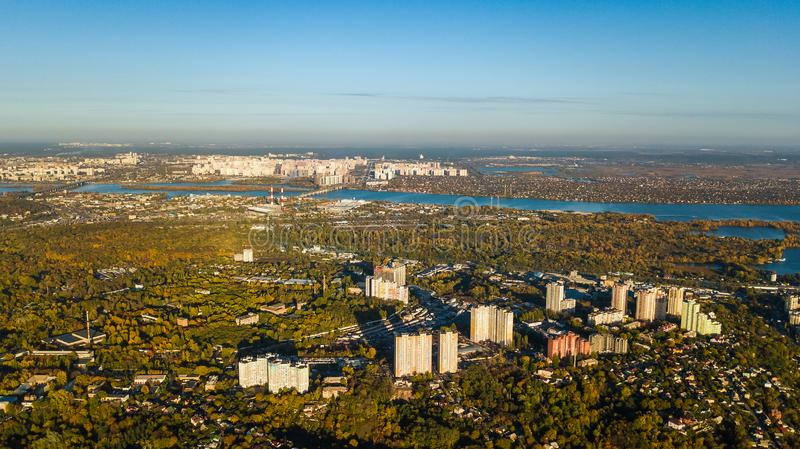 Golden autumn Kyiv cityscape, aerial drone view of city skyline and forest with yellow trees and beautiful landscape from above. Kiev, Goloseevo forest royalty free stock photo