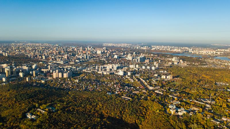 Golden autumn Kyiv cityscape, aerial drone view of city skyline and forest with yellow trees and beautiful landscape from above. Kiev, Goloseevo forest royalty free stock photos