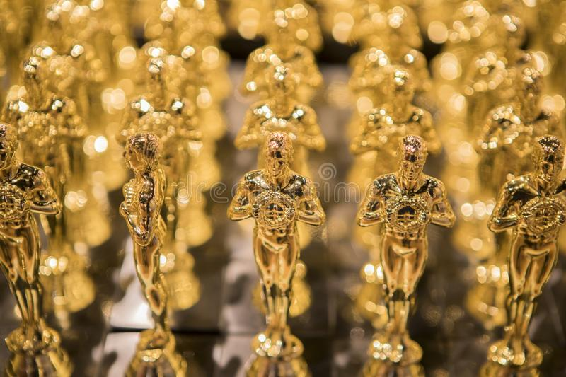 Golden Awards In a Row. Golden awards in row and shiny stock photography