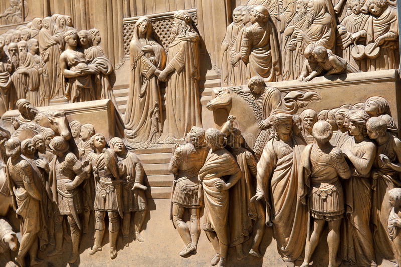 Golden ba-reliefs. Golden bareliefs from the main cathedral in Florence, Italy stock image