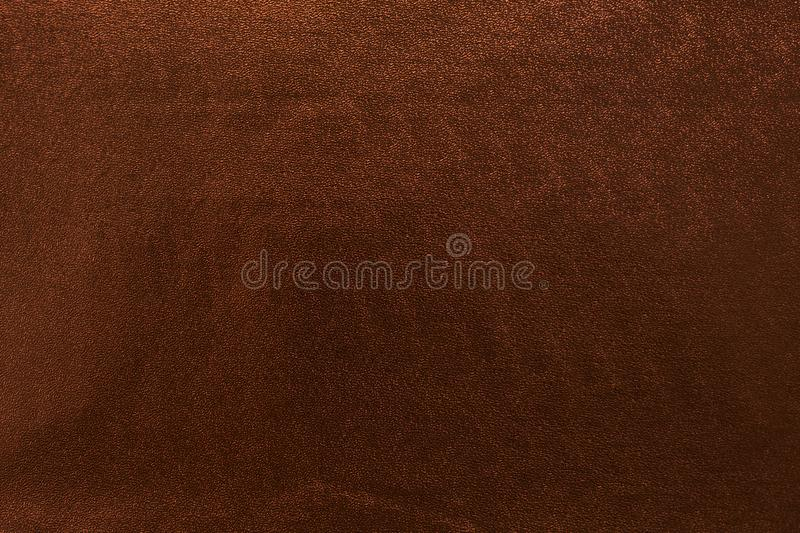 Golden background with textural dark highlights and bokeh stock photography