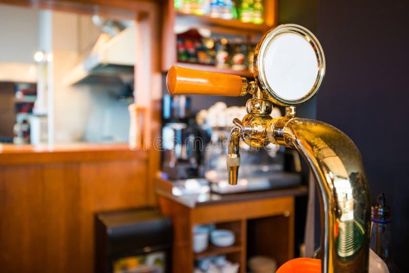 Golden Bar Beer Tap. Closeup Photo. Pub Equipment stock image