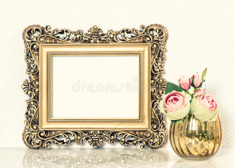 Golden baroque picture frame and roses flowers bouquet. Retro st royalty free stock photos