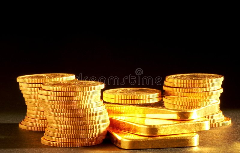 Golden bars and coins. 999,9 pure gold bullion and pounds royalty free stock photos