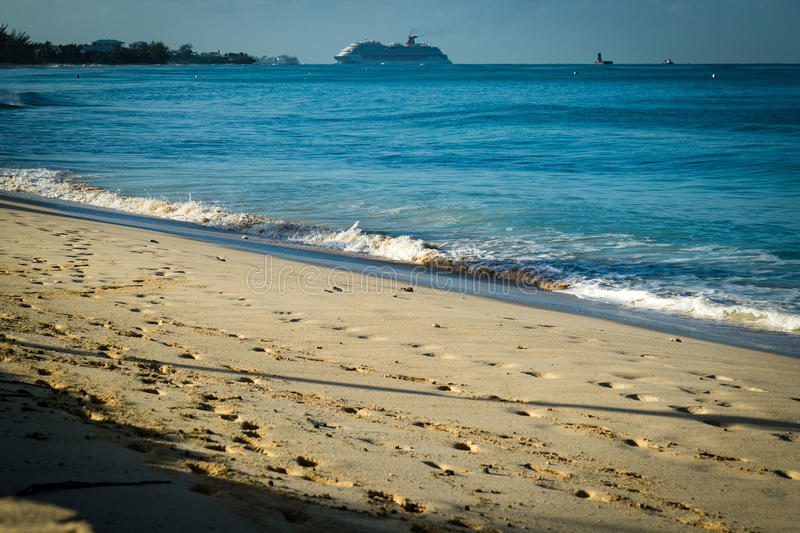 Golden beach in the tropics. A view of golden beach in the caribbean with clear blue waters royalty free stock photography