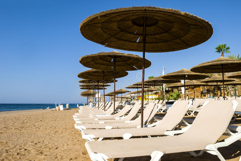 Golden beach is waiting for tourists Eilat, Israel. Eilat is a famous resort and recreational city of Israel royalty free stock photography
