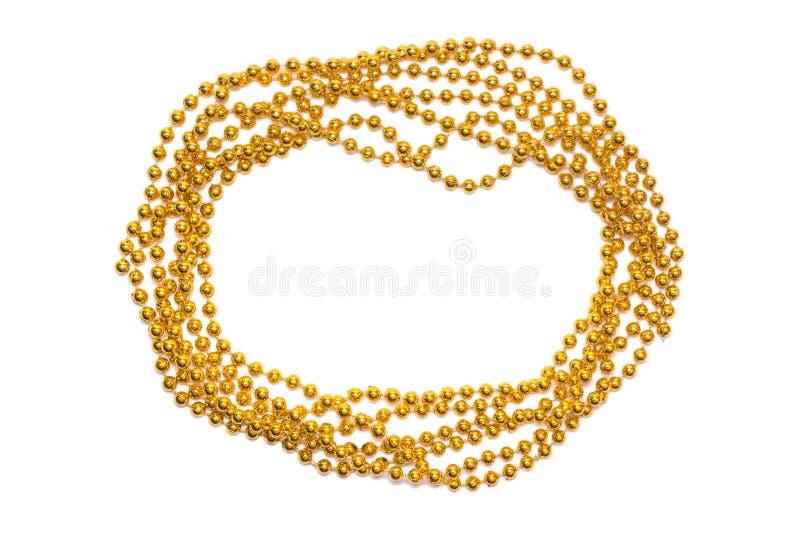 Golden beads border isolated. Christmas frame. Golden shine. Yellow background. Golden beads border isolated. Christmas frame. Golden shine. Yellow background royalty free stock photo