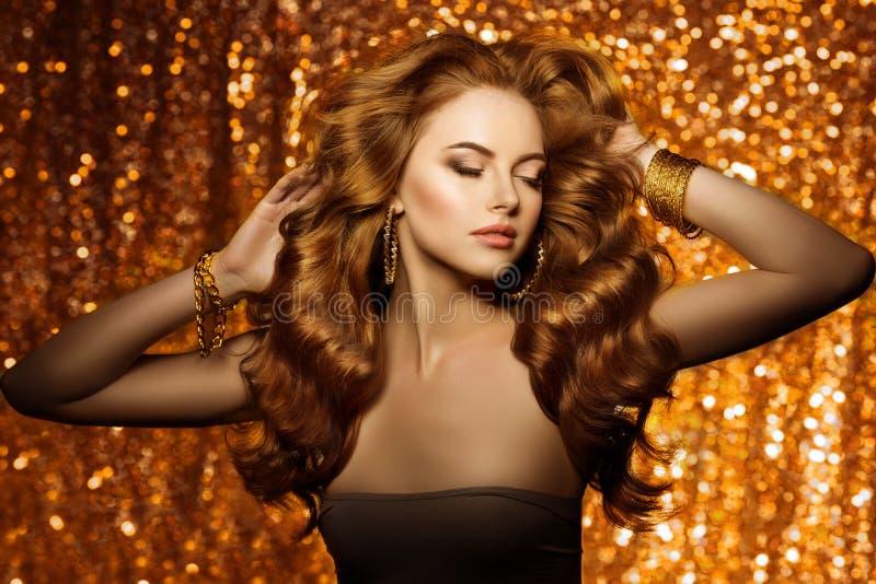 Golden beautiful fashion woman, model with shiny healthy long v royalty free stock photos