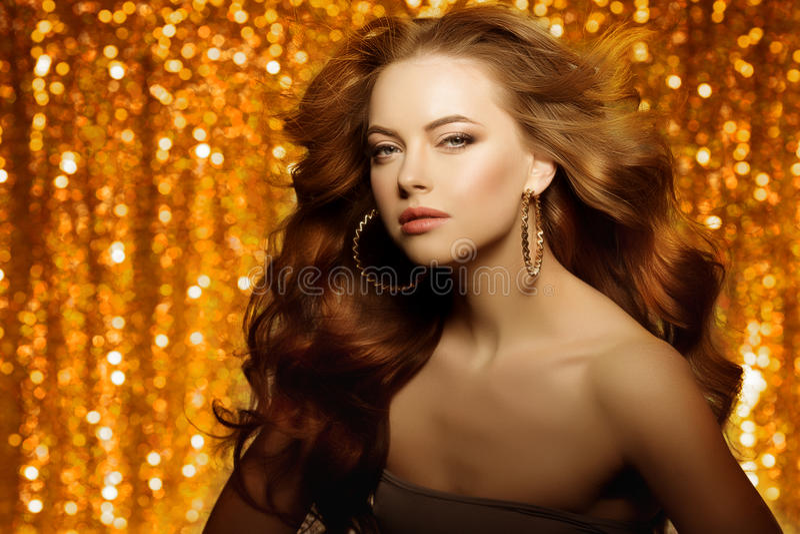 Golden beautiful fashion woman, model with shiny healthy long v royalty free stock photo