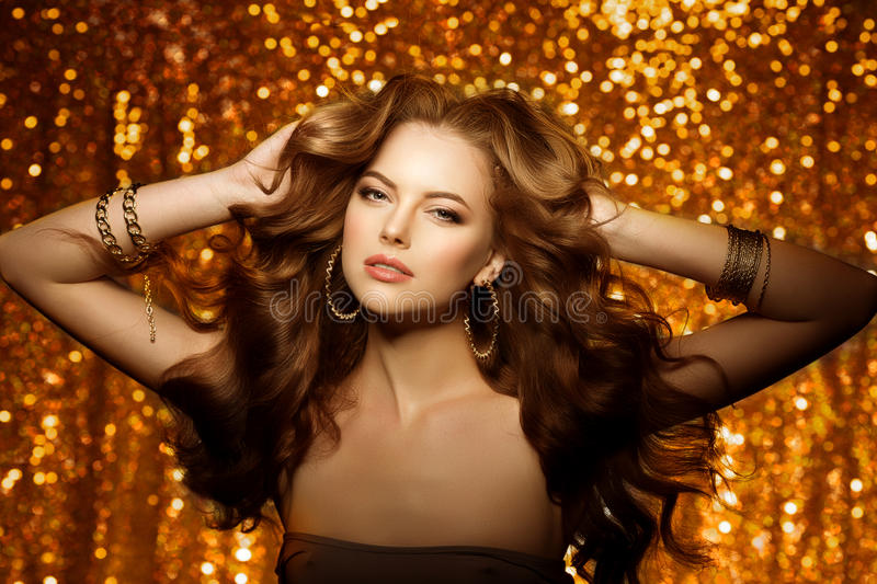 Golden beautiful fashion woman, model with shiny healthy long v royalty free stock images