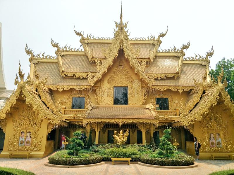 Golden beautiful paint building decorated with Thai stucco pattern is toilet of Rong Khun temple Wat Rong Khun. stock photos