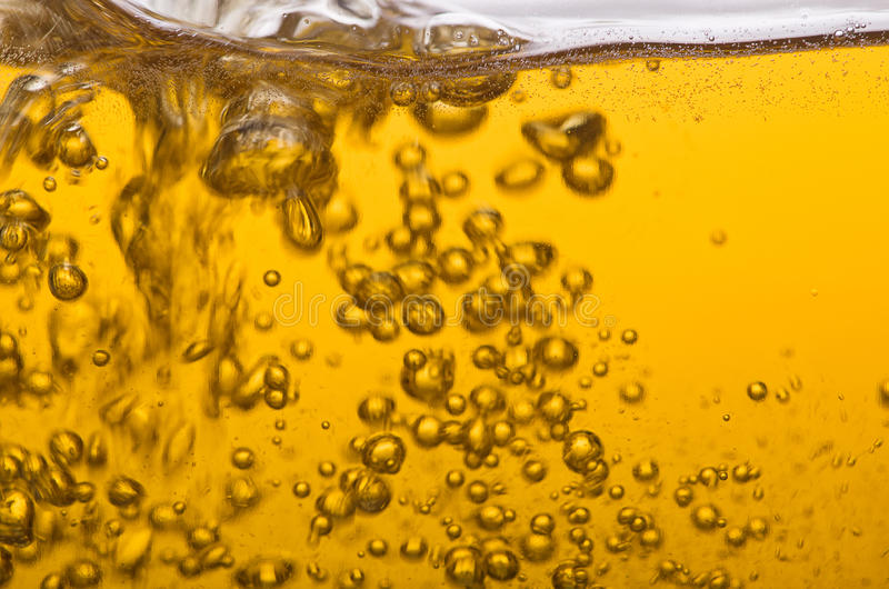 Golden beer. Delicious golden beer poured into a pint royalty free stock images