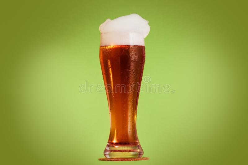 Golden beer in glass with foam, alcohol beverage,  froth stock photography