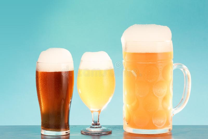 Golden beer in glass with foam, alcohol beverage,  lager closeup stock photos