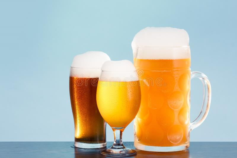 Golden beer in glass with foam, alcohol beverage,  lager pint royalty free stock photos