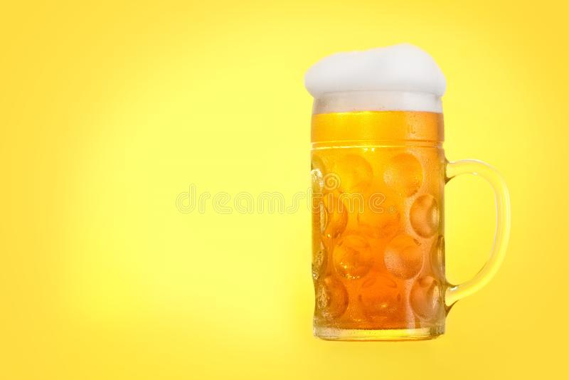 Golden beer in glass with foam, alcohol beverage,  pint royalty free stock image