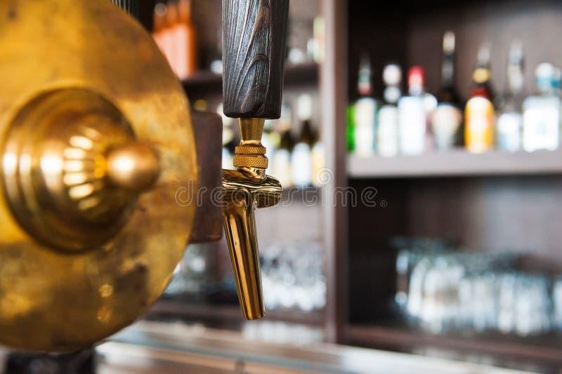 Golden beer tap. Golden shiny beer taps in beer bar stock photography