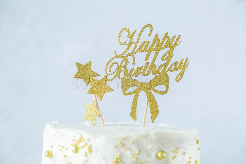 Golden birthday concept - cake, presents, decorations stock photography