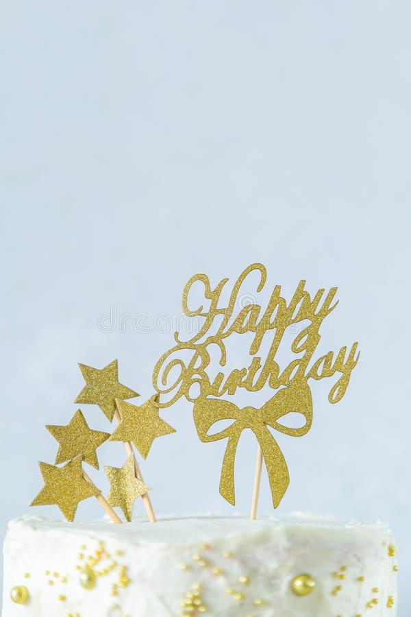 Golden birthday concept - cake, presents, decorations stock images