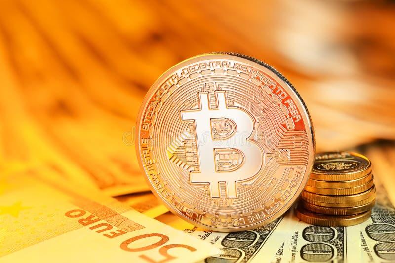 Golden Bitcoin and banknotes royalty free stock photos