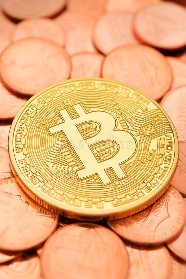 Golden Bitcoin and cents stock photography
