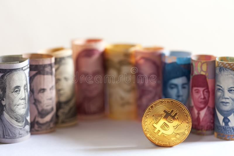 Golden Bitcoin and banknotes royalty free stock image