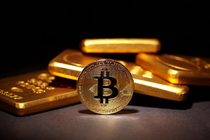 Golden Bitcoin Coin and Gold Bars stock images