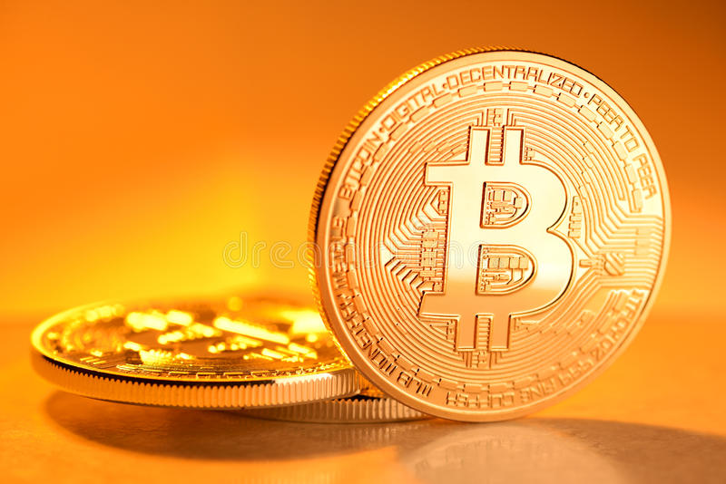 Golden Bitcoin coin. On yellow background. Electronic money, cryptocurrency stock photo