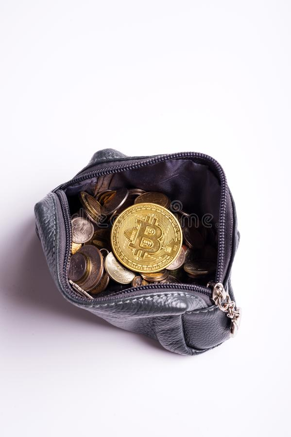 Golden   bitcoin coins over  money coins  in wallet around white background royalty free stock image