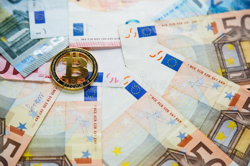 Golden Bitcoin Crypto currency coin on euro banknotes. Investments, cryptocurrency digital payment concept, royalty free stock images