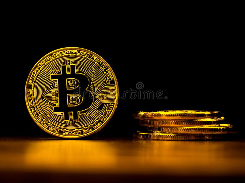 Golden bitcoin cryptocurrency banking money transfer business technology with black background. Concept of distributed ledger. Technology and digital electronic royalty free stock photos