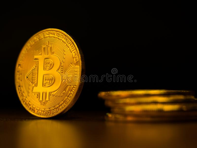 Golden bitcoin cryptocurrency banking money transfer business technology with black background. Concept of distributed ledger tech. Nology and digital electronic royalty free stock photography