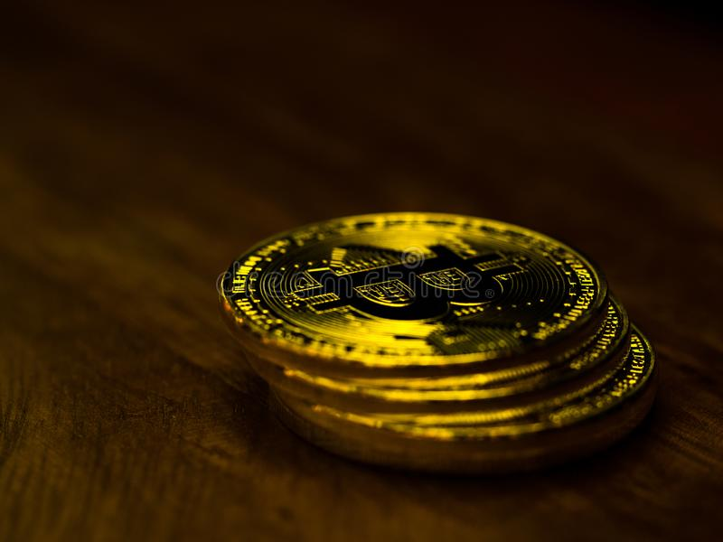Golden bitcoin cryptocurrency banking money transfer business technology on wooden table. Concept of distributed ledger technology. And digital electronic stock photo