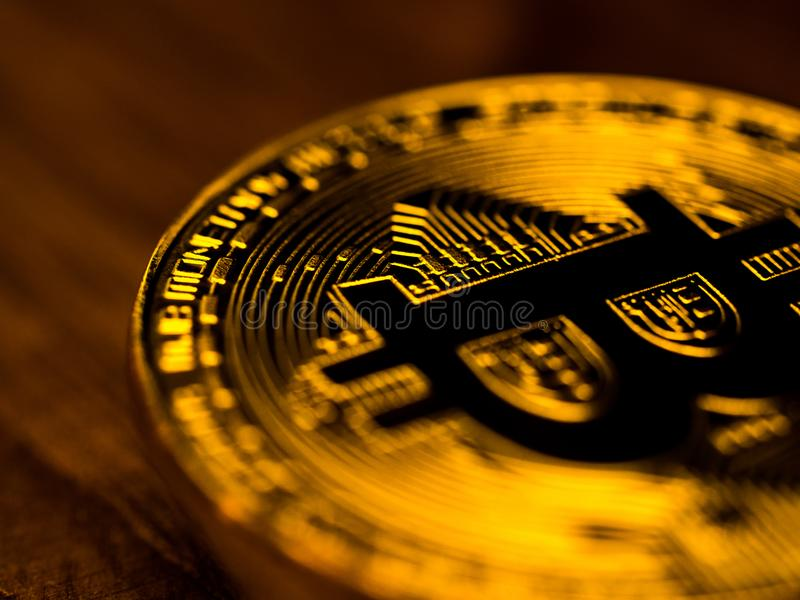 Golden bitcoin cryptocurrency banking money transfer business technology on wooden table. Concept of distributed ledger technology. And digital electronic royalty free stock images